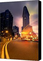 Nyc Photo Canvas Prints - The Flat Iron Building with some magic happening Canvas Print by John Farnan