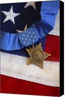 American Flags Canvas Prints - The Medal Of Honor Rests On A Flag Canvas Print by Stocktrek Images