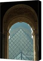 The Louvre Museum Canvas Prints - The pyramid of the Musee du Louvre seen through an arched window Canvas Print by Sami Sarkis