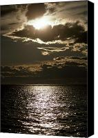 Valdes Canvas Prints - The Setting Sun Pierces A Menacing Canvas Print by Jason Edwards