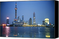 Twilight Views Canvas Prints - The Shanghai Skyline And Riverfront Canvas Print by Raul Touzon