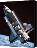 Challenge Canvas Prints - The Space Shuttle With Cargo Bay Open Orbiting Above Earth Canvas Print by Stockbyte