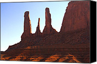 Pillars Canvas Prints - Three Sisters - Monument Valley Canvas Print by Mike McGlothlen