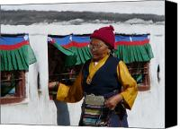 Tibetan Canvas Prints - Tibetan Grandmother turning the Prayer Wheel Canvas Print by Dagmar Ceki
