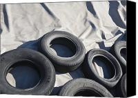 Garbage Canvas Prints - Tires and Tarp Covering a Pile Canvas Print by Paul Edmondson