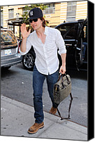 Waving Canvas Prints - Tom Cruise Carrying A Filson Bag Canvas Print by Everett