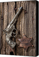 Star Canvas Prints - Toy gun and ranger badge Canvas Print by Garry Gay