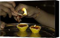 Oil Lamp Canvas Prints - Trying to light an oil lamp that has gone out Canvas Print by Ashish Agarwal