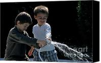 10:7 Canvas Prints - Two boys playing with garden hose Canvas Print by Sami Sarkis