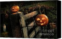 Graveyard Canvas Prints - Two halloween pumpkins sitting on fence Canvas Print by Sandra Cunningham