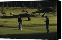 Photographs With Red. Canvas Prints - Two People Play Golf While Elk Graze Canvas Print by Raymond Gehman