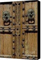 Door Handles Canvas Prints - Typical Andalusian style wooden studded door Canvas Print by Sami Sarkis