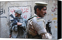 Insurgency Canvas Prints - Us And Iraqi Army Soldiers Stand Guard Canvas Print by Everett