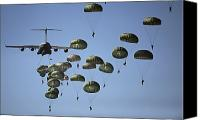 Rear Canvas Prints - U.s. Army Paratroopers Jumping Canvas Print by Stocktrek Images