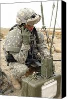 Talking Canvas Prints - U.s. Army Soldier Performs A Radio Canvas Print by Stocktrek Images