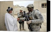 Conversing Photo Canvas Prints - U.s. Army Soldier Shakes Hands With An Canvas Print by Stocktrek Images