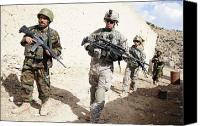 Foot Patrol Canvas Prints - U.s. Army Troops Lead A Patrol Canvas Print by Stocktrek Images