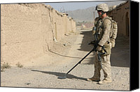 Insurgency Canvas Prints - U.s. Marine Sweeping For Improvised Canvas Print by Everett