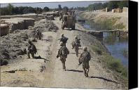 Foot Patrol Canvas Prints - U.s. Marines Conduct A Security Patrol Canvas Print by Stocktrek Images