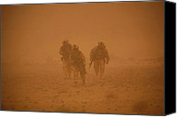 Insurgency Canvas Prints - U.s. Marines In A Sand Storm Returning Canvas Print by Everett