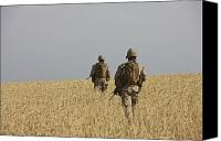 Foot Patrol Canvas Prints - U.s. Marines Patrol A Wadi Near Kunduz Canvas Print by Terry Moore