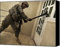 Second Gulf War Canvas Prints - Us Soldier Breaks Down A Door Canvas Print by Everett