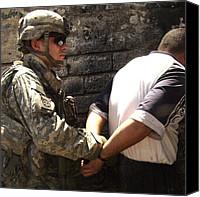 Second Gulf War Canvas Prints - Us Soldier Cuffs An Iraqi Man Suspected Canvas Print by Everett