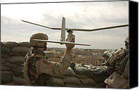 Iraq Canvas Prints - Us Soldier Launches A Raven Unmanned Canvas Print by Everett