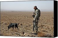 Titles Canvas Prints - Us Soldier Works With A Dog Identified Canvas Print by Everett