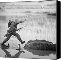 Foreign Wars Canvas Prints - Vietnam War. A Us Marine Rifleman Leaps Canvas Print by Everett