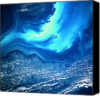 Astronomy Canvas Prints - View Of Land And Sea From Space Canvas Print by Stockbyte