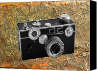 Rangefinder Canvas Prints - Vintage 35mm rangefinder camera Canvas Print by Kenneth William Caleno