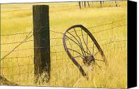 Barbed Wire Fences Photo Canvas Prints - Wheel looking for a Tractor Canvas Print by Rich Franco