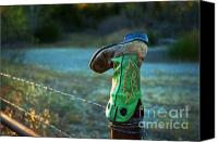 Barbed Wire Fences Photo Canvas Prints - Where Good Boots Go Canvas Print by Fred Lassmann