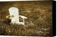 Grow Digital Art Canvas Prints - White chair with straw hat in a field Canvas Print by Sandra Cunningham