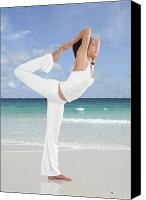 Training Canvas Prints - Woman doing yoga on the beach Canvas Print by Setsiri Silapasuwanchai