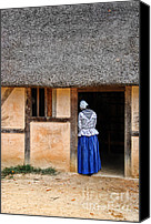 Jamestown Canvas Prints - Woman in Doorway of a Thatched Roof Cottage Canvas Print by Jill Battaglia