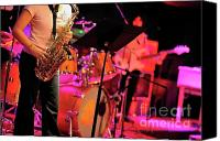 Musical Imagery Canvas Prints - Woman playing saxophone on stage with her band Canvas Print by Sami Sarkis