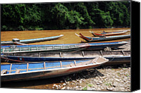 Southeast Asia Canvas Prints - Wooden Boat On River In Laos Canvas Print by Thepurpledoor