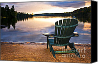 Sunrise Canvas Prints - Wooden chair at sunset on beach Canvas Print by Elena Elisseeva