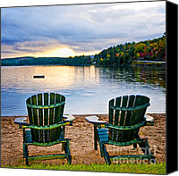 Vacation Canvas Prints - Wooden chairs at sunset on beach Canvas Print by Elena Elisseeva