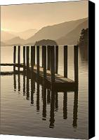 Docks Photo Canvas Prints - Wooden Dock In The Lake At Sunset Canvas Print by John Short