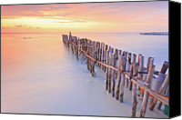 Wooden Post Canvas Prints - Wooden Posts Into  Sea Canvas Print by Enzo Figueres