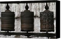 Tibetan Buddhism Photo Canvas Prints - Wooden Prayer Wheels Canvas Print by Sean White