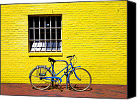 Yellow Building Canvas Prints - Yellow Wall and Blue Bicycle Canvas Print by Steven Ainsworth