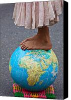 Foot Canvas Prints - Young woman standing on globe Canvas Print by Garry Gay