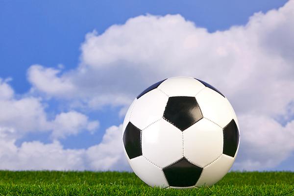 Football On Grass Print by Richard Thomas