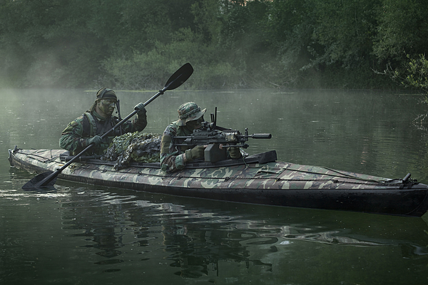 Navy Seals Navigate The Waters Print by Tom Weber