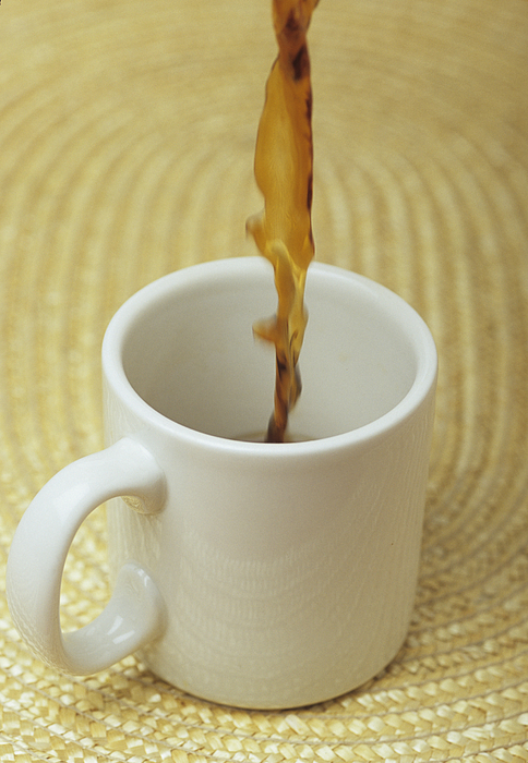 A Cup Of Energy Filled Coffee Is Poured Print by Taylor S. Kennedy