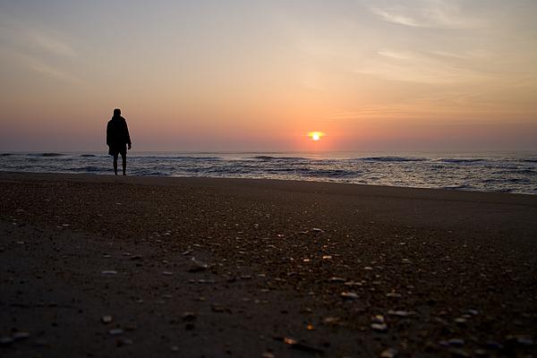A Lone Figure Enjoys The Ocean Sunrise Print by Stephen St. John
